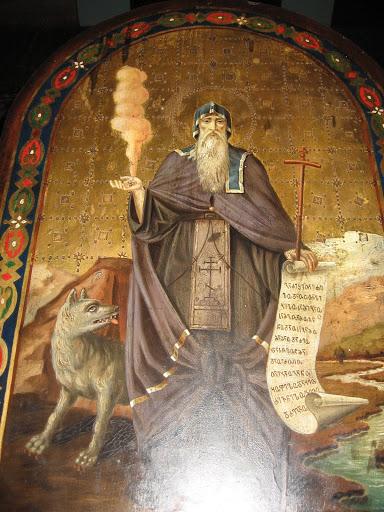 Волк, получив свободу, удалился от святого в горы.